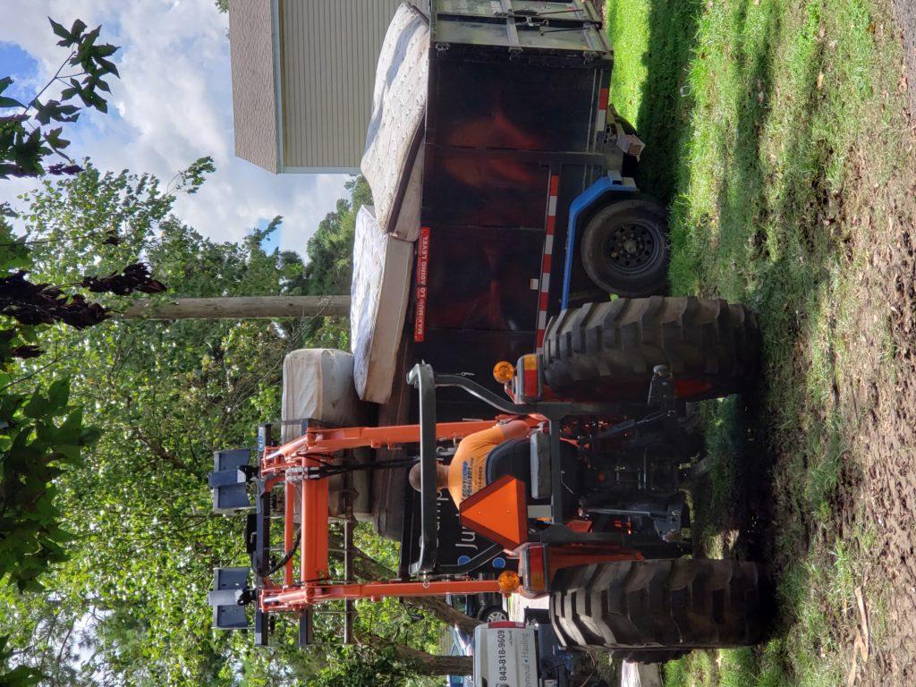 tractor wirh mattress cleanup